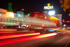 Las vegas in motion. A street view of vehicle motion blur from the tail lights as they drive down the main strip in Las Vegas, Nevada