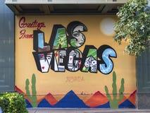 Las Vegas, Nevada 4-23-16: Groeten van Prentbriefkaarmuurschildering bij de Stadsbouw Stock Afbeeldingen