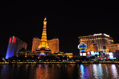 LAS VEGAS, NEVADA, USA - APRIL 22, 2015 : Night view of the dancing fountains of Bellagio and the Eiffel Tower. Replica of Paris hotel in Las Vegas Nevada, on Stock Photo