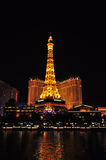 LAS VEGAS, NEVADA, USA - APRIL 22, 2015 : Night view of the dancing fountains of Bellagio and the Eiffel Tower. Replica of Paris hotel in Las Vegas Nevada, on Stock Photography