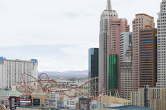 Las Vegas New York and a roller coaster. LAS VEGAS - AUGUST 7: Image of Miniature New York and the Big Apple Roller Coaster in the world famous Las Vegas which Royalty Free Stock Photo
