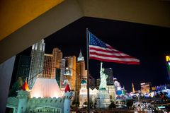 Las Vegas at night. American flag in front. royalty free stock photography