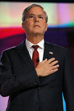 LAS VEGAS, NV - DECEMBER 15: Republican presidential candidate and former Gov Jeb Bush holds hand over heart for pledge of allegia Royalty Free Stock Photo