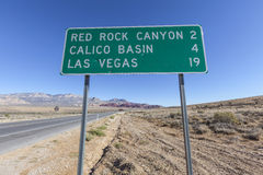 Las Vegas and Red Rock Canyon Sign with Bullet Holes Stock Photos