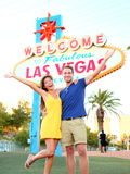 Las Vegas Sign - couple jumping having fun Stock Photos