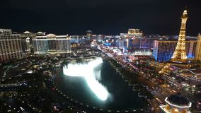 Las Vegas Strip Fountains Night. Editorial night time lapse clip of the famous fountains between Bellagio and Paris resorts on the Las Vegas strip stock video footage