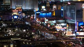 Las Vegas Strip Night Time Lapse Tele. Editorial time lapse clip of Caesars Palace and other resorts on the Las Vegas strip stock video footage
