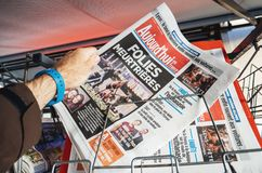 2017 Las Vegas Strip shooting aujord`hui french newspaper. PARIS, FRANCE - OCT 3, 2017: Man buying Aujord`hui French newspaper with socking title and photo at Stock Photos