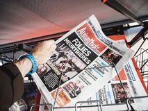 2017 Las Vegas Strip shooting aujord`hui french newspaper. PARIS, FRANCE - OCT 3, 2017: Man buying Aujord`hui French newspaper with socking title and photo at Royalty Free Stock Images