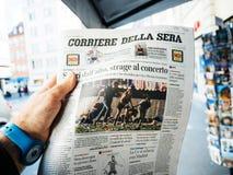 2017 Las Vegas Strip shooting newspaper Corriere della sera ital. PARIS, FRANCE - OCT 3, 2017: Man buying Corriere della Sera newspaper with socking title and Stock Image