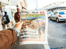 2017 Las Vegas Strip shooting newspaper newspaper; paper; news;. PARIS, FRANCE - OCT 3, 2017: Man buying Daily Dail newspaper with socking title and photo at Stock Image