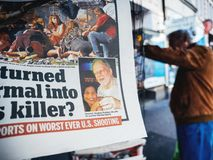2017 Las Vegas Strip shooting newspaper Photo of killer Stephen. PARIS, FRANCE - OCT 3, 2017: Photo of killer Stephen Paddock in newspaper with socking title and royalty free stock image