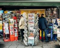 2017 Las Vegas Strip shooting people buying press. PARIS, FRANCE - OCT 3, 2017: People Seniors buying international newspapers at kisok with socking title photos Stock Image