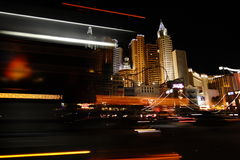 Las Vegas Strip Traffic. Skyline of las vegas buildings with vehicles streaking by in the foreground Royalty Free Stock Photo
