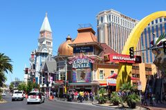 Las Vegas Strip. LAS VEGAS, USA - APRIL 14, 2014: People visit the famous Strip in Las Vegas. 15 of 25 largest hotels in the world are located at the strip with Royalty Free Stock Photography