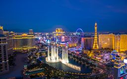 Las Vegas strip view from high rise balcony. Aerial View of City. Las Vegas, USA - January 02, 2018: Illuminated view Bellagio Hotel fountains and Las Vegas royalty free stock photography