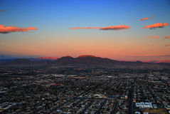 Las Vegas Sunrise. Las Vegas strip aerial view at sunrise with mountain peak lit by sunshine royalty free stock photo