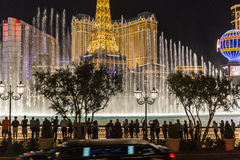 Las Vegas Tourists. Las Vegas, Nevada, USA - October 10, 2015:  Limo passing line of tourists photographing the Bellagio fountains on the Las Vegas strip Royalty Free Stock Images