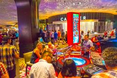 Las Vegas, United States of America - May 06, 2016: The people playing at slot machines in the Excalibur Hotel and. Casino at Las Vegas, United States of Stock Images