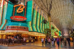 Fremont Street with many neon lights and tourists in Las Vegas Stock Photo