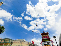 Las Vegas, USA - May 07, 2016: A people riding on the SlotZilla zip line attraction at the Fremont Street Experience. stock photography