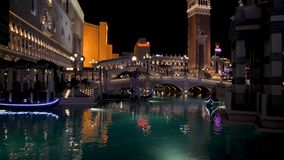 Las Vegas, USA-November 07,2017: Hotel Venice With Canal And Gondoliers At Night stock footage