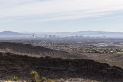 Las Vegas View. Las Vegas, Nevada, USA - November 29, 2014:  Las Vegas downtown strip and valley haze viewed from nearby rugged Mojave desert ridges Stock Photos