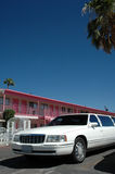 Las Vegas Wedding Motel. A cheap looking pink motel and a white limousine ready for the next wedding in Las Vegas stock photo