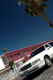 Las Vegas Wedding Motel. A cheap looking pink motel and a white limousine ready for the next wedding in Las Vegas royalty free stock photos