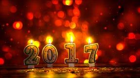 Las velas ardientes numeran 2017 y colorido asperja con glitteri Imágenes de archivo libres de regalías