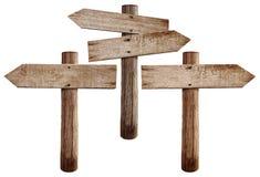 Las viejas señales de tráfico de madera enderezan, izquierdo y ambas flechas Imágenes de archivo libres de regalías