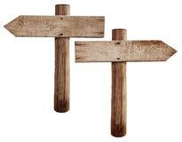 Las viejas señales de tráfico de madera enderezan y las flechas izquierdas Imagen de archivo