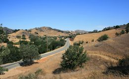 Las Virgenes Road. Road through rolling hills, Malibu, CA Stock Images