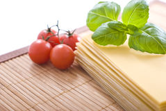 Lasagna. Pasta with basil and tomateos. Ingredients for Stock Photos