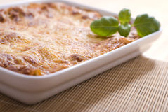 Lasagna. With basil in casserole Stock Photography