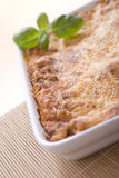 Lasagna. With basil in casserole Royalty Free Stock Photos