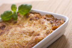 Lasagna. With basil in casserole Royalty Free Stock Photo