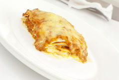 Lasagna. Appetizing lasagna on a white plate Stock Image