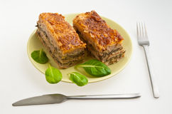Lasagna. With cornsalad on a plate royalty free stock images