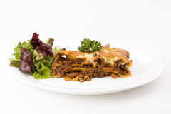 Lasagna. Piece of lasagna al forno with some salad Stock Photo