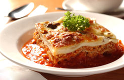 Lasagna. Cheesy Italian lasagna with tomato sauce Royalty Free Stock Images