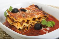 Lasagna. With olives and herbs stock images