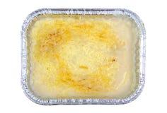 Lasagna in aluminium recipient isolated on white. Royalty Free Stock Photos