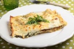 Lasagna with arugula on a plate Stock Photos