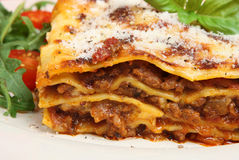 Lasagna with Beef. Beef lasagna topped with grated Parmesan cheese Royalty Free Stock Images