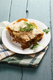 Lasagna with bolognese and bechamel. On a wooden tabletop stock photography