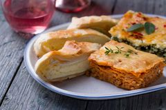 Lasagna and Camembert cheese pie. Lasagna with bolognese and Camembert cheese pie Stock Image