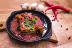 Lasagna bolognese in a hot frying pan Stock Image