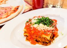 Lasagna bolognese plate, traditional recipe with tomato sauce, cheese and meat stock photos