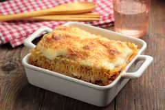 Lasagna bolognese on a rustic table Stock Photography